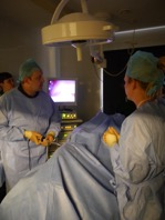 Delyth and David in theatre at Bridge performing a laparoscopic procedure